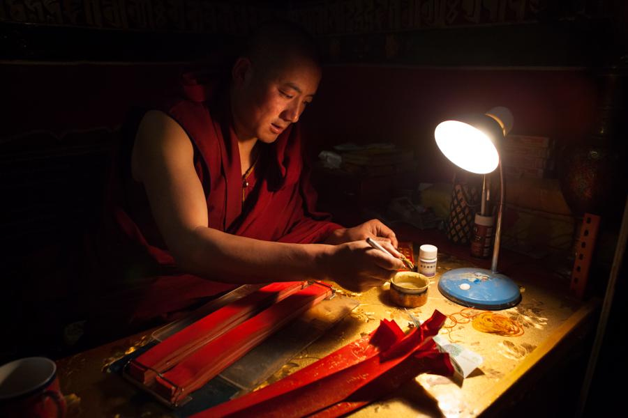 http://www.lauraportinaro.com/files/gimgs/69_tibetan-monk-writng-prayers.jpg